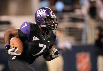 ARLINGTON, TX - OCTOBER 28:  Greg McCoy #7 of the TCU Horned Frogs runs during a game against the BYU Cougars at Cowboys Stadium on October 28, 2011 in Arlington, Texas. The TCU Horned Frogs defeated the BYU Cougars 38-28.  (Photo by Sarah Glenn/Getty Ima
