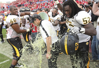 HOUSTON - DECEMBER 03:  Head coach Larry Fedora of the Southern Miss Golden Eagles is doused with Gatorade by Joe Duhon #68 and Jason Weaver #52 after defeating the Houston Cougars 49-28 in the Conference USA championship game at Robertson Stadium on Dece