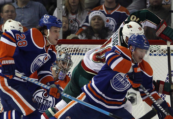 EDMONTON, CANADA - NOVEMBER 30: Ryan Jones #28 and Ladislav Smid #5 of the Edmonton Oilers defend the net against the Minnesota Wild at Rexall Place on November 30, 2011 in Edmonton, Canada. (Photo by Bruce Bennett/Getty Images)