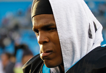 CHARLOTTE, NC - DECEMBER 11:  Cam Newton #1 of the Carolina Panthers walks off the field after being defeated by the Atlanta Falcons after their game at Bank of America Stadium on December 11, 2011 in Charlotte, North Carolina.  (Photo by Streeter Lecka/G