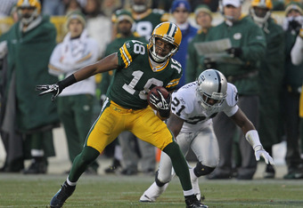GREEN BAY, WI - DECEMBER 11:  Randall Cobb #18 of the Green Bay Packers moves past Lito Sheppard #21 of the Oakland Raiders at Lambeau Field on December 11, 2011 in Green Bay, Wisconsin. The Packers defeated the Raiders 46-16.  (Photo by Jonathan Daniel/G