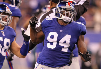 EAST RUTHERFORD, NJ - NOVEMBER 20:  Mathias Kiwanuka #94 of the New York Giants reacts against the Philadelphia Eagles at MetLife Stadium on November 20, 2011 in East Rutherford, New Jersey.  (Photo by Al Bello/Getty Images)