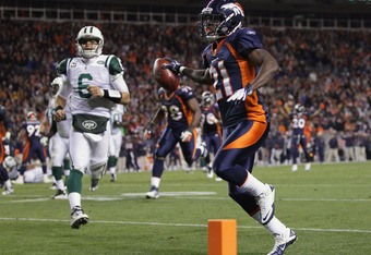 DENVER, CO - NOVEMBER 17:  Cornerback Andre' Goodman #21 of the Denver Broncos returns an interception of a pass by quarterback Mark Sanchez #6 of the New York Jets 26 yards for a third quarter touchdown at Sports Authority Field at Mile High on November