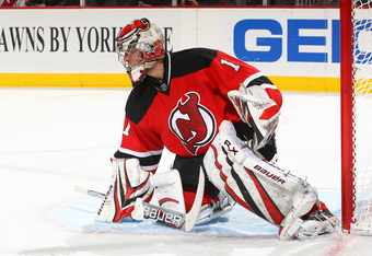 NEWARK, NJ - DECEMBER 08:  Johan Hedberg #1 of the New Jersey Devils  in action against the Ottawa Senators during their game on December 8, 2011 at The Prudential Center in Newark, New Jersey  (Photo by Al Bello/Getty Images)