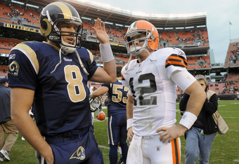 CLEVELAND, OH - NOVEMBER 13: Quarterbacks Sam Bradford #8 of the St. Louis Rams and Colt McCoy #12 of the Cleveland Browns talk after the Rams defeated the Browns 13-12 at Cleveland Browns Stadium on November 13, 2011 in Cleveland, Ohio. The Rams defeated