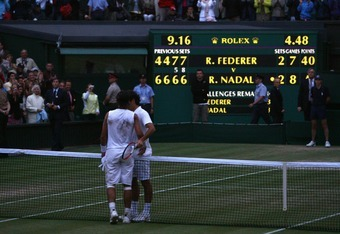 LONDON - JULY 06:  Rafael Nadal of Spain shakes hands with Roger Federer of Switzerland after Nadal won in five sets in the final on day thirteen of the Wimbledon Lawn Tennis Championships at the All England Lawn Tennis and Croquet Club on July 6, 2008 in