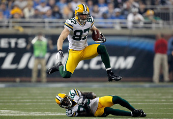 DETROIT, MI - NOVEMBER 24:  Wide receiver Jordy Nelson #87 of the Green Bay Packers leaps over teammate Donald Driver #80 in the third quarter against the Detroit Lions during the Thanksgiving Day game at Ford Field on November 24, 2011 in Detroit, Michig