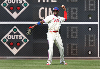 PHILADELPHIA - JULY 24: Right fielder Domonic Brown #9 of the Philadelphia Phillies throws to second base during a game against the San Diego Padres at Citizens Bank Park on July 24, 2011 in Philadelphia, Pennsylvania. The Phillies won 5-3. (Photo by Hunt
