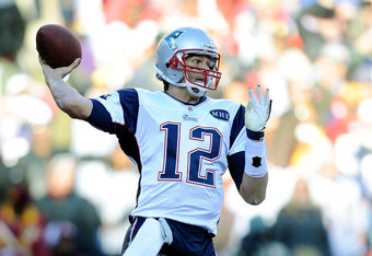 LANDOVER, MD - DECEMBER 11:   Tom Brady #12 of the New England Patriots throws a pass against the Washington Redskins at FedExField on December 11, 2011 in Landover, Maryland.  (Photo by Patrick McDermott/Getty Images)