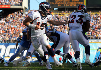 SAN DIEGO, CA - NOVEMBER 27:  Quarterback Tim Tebow #15 of the Denver Broncos passes the ball to Runningback Willis McGahee #23 against the San Diego Chargers during their NFL Game on November 27, 2011 at Qualcomm Stadium in San Diego, California..  (Phot
