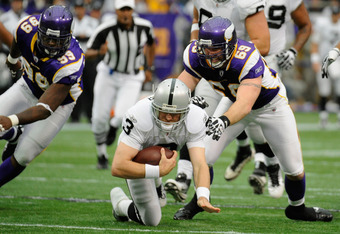 MINNEAPOLIS, MN - NOVEMBER 20: Carson Palmer #3 of the Oakland Raiders runs with the ball as Jared Allen #69 of the Minnesota Vikings gives chase in the first quarter on November 20, 2011 at Hubert H. Humphrey Metrodome in Minneapolis, Minnesota. (Photo b