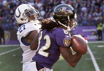 BALTIMORE, MD - DECEMBER 11:  Jacob Lacey #27 of the Indianapolis Colts breaks up a pass intended for Torrey Smith #82 of the Baltimore Ravens during the first half at M&T Bank Stadium on December 11, 2011 in Baltimore, Maryland.  (Photo by Rob Carr/Getty