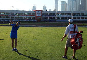 Women's Golf: Dubai Ladies Masters, 18th Hole on the Final Day of Competition, Dec. 17, 2011. Notice the fairly vacant viewing structure past the green.