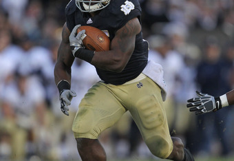 SOUTH BEND, IN - OCTOBER 29:  Jonas Gray #25  of the Notre Dame Fighting Irish runs for yardage against the Navy Midshipmen at Notre Dame Stadium on October 29, 2011 in South Bend, Indiana. Notre Dame defeated Navy 56-14.  (Photo by Jonathan Daniel/Getty