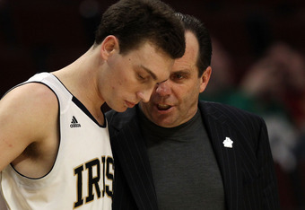 CHICAGO, IL - MARCH 20: Ben Hansbrough #23 of the Notre Dame Fighting Irish talks with head coach Mike Brey in the second half during the third round of the 2011 NCAA men's basketball tournament at the United Center on March 20, 2011 in Chicago, Illinois.