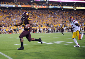 TEMPE, AZ - SEPTEMBER 24:  Cameron Marshall #6 of the Arizona State Sun Devils scores a touchdown on a long first quarter run against the University of Southern California Trojans at Sun Devil Stadium on September 24, 2011 in Tempe, Arizona.  (Photo by No