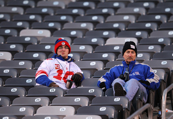 EAST RUTHERFORD, NJ - DECEMBER 18:  New York Giants fans look on after the Giants 23-10 loss against the Washington Redskins after their game at MetLife Stadium on December 18, 2011 in East Rutherford, New Jersey.  (Photo by Al Bello/Getty Images)