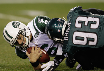 PHILADELPHIA, PA - DECEMBER 18:  Mark Sanchez #6 of the New York Jets is sacked by Jason Babin #93 of the Philadelphia Eagles during the first half at Lincoln Financial Field on December 18, 2011 in Philadelphia, Pennsylvania.  (Photo by Rob Carr/Getty Im