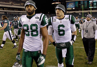 PHILADELPHIA, PA - DECEMBER 18:  Patrick Turner #88 and  Mark Sanchez #6 of the New York Jets walk off the field following the Jets 45-19 loss to the Philadelphia Eagles at Lincoln Financial Field on December 18, 2011 in Philadelphia, Pennsylvania.  (Phot