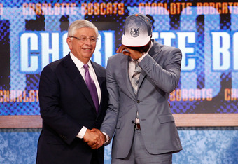 NEWARK, NJ - JUNE 23:  Kemba Walker from UCONN is overcomer with emotion as he greets NBA Commissioner David Stern after he was selected #7 overall by the Charlotte Bobcats in the first round during the 2011 NBA Draft at the Prudential Center on June 23,