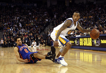 OAKLAND, CA - NOVEMBER 19:  Monta Ellis #8 of the Golden State Warriors dribbles the ball after Danillo Gallinari #8 of the New York Knicks falls down at Oracle Arena on November 19, 2010 in Oakland, California. NOTE TO USER: User expressly acknowledges a