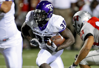 LAS VEGAS - OCTOBER 30:  Waymon James #32 of the Texas Christian University Horned Frogs runs for yardage against the UNLV Rebels at Sam Boyd Stadium October 30, 2010 in Las Vegas, Nevada. TCU won 48-6.  (Photo by Ethan Miller/Getty Images)