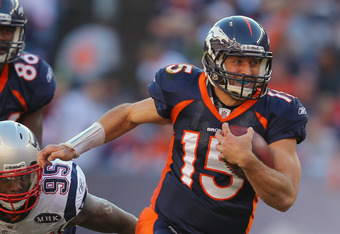 DENVER, CO - DECEMBER 18:  Quarterback Tim Tebow #15 of the Denver Broncos rushes with the ball against the New England Patriots at Sports Authority Field at Mile High on December 18, 2011 in Denver, Colorado. The Patriots defeated the Broncos 41-23.  (Ph