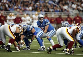 DETROIT - OCTOBER 26:  Dan Orlovsky #6 of the Detroit Lions stands under center Dominic Raiola #51 during the game against the Washington Redskins on October 26, 2008 at Ford Field in Detroit, Michigan.  (Photo by Domenic Centofanti/Getty Images)