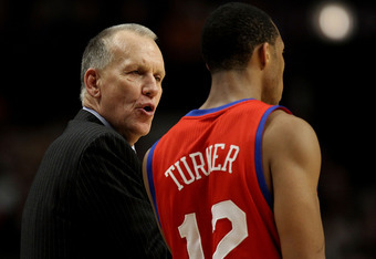 CHICAGO, IL - DECEMBER 21: Head coach Doug Collins of the Philadelphia 76ers gives instructions to Evan Turner #12 during a game against the Chicago Bulls at the United Center on December 21, 2010 in Chicago, Illinois. The Bulls defeated the 76ers 121-76.
