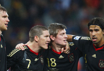 PORT ELIZABETH, SOUTH AFRICA - JULY 10: Per Mertesacker, Bastian Schweinsteiger, Toni Kroos and Sami Khedira of Germany celebrate victory following the 2010 FIFA World Cup South Africa Third Place Play-off match between Uruguay and Germany at The Nelson M