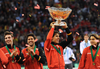 SEVILLE, SPAIN - DECEMBER 04:  Rafael Nadal of Spain holds the Davis Cup trophy aloft as he celebrates with his teammates during the third and last day of the final Davis Cup match between Spain and Argentina on December 4, 2011 in Seville, Spain.  (Photo