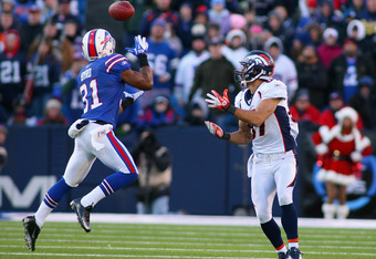 ORCHARD PARK, NY - DECEMBER 24: Jairus Byrd #31 of the Buffalo Bills steps in to intercept a pass intended for  Eric Decker #87 of the Denver Broncos at Ralph Wilson Stadium on December 24, 2011 in Orchard Park, New York. Byrd ran the interception 37 yard