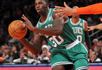 NEW YORK, NY - DECEMBER 25: Brandon Bass #30 of the Boston Celtics passes the ball during the first half against the New York Knicks at Madison Square Garden on December 25, 2011 in New York City. NOTE TO USER: User expressly acknowledges and agrees that,
