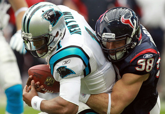 HOUSTON, TX - DECEMBER 18:   Cam Newton #1 of the Carolina Panthers is sacked by  Connor Barwin #98 of the Houston Texans at Reliant Stadium on December 18, 2011 in Houston, Texas.  (Photo by Ronald Martinez/Getty Images)