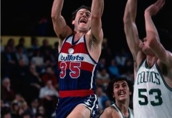 Kevin Grevey goes up against Chris Ford and Rick Robey of the Boston Celtics.