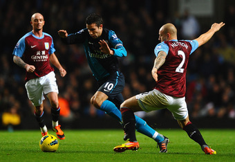 BIRMINGHAM, ENGLAND - DECEMBER 21:  Robin Van Persie of Arsenal skips past Alan Hutton of Aston Villa during the Barclays Premier League match between Aston Villa and Arsenal at Villa Park on December 21, 2011 in Birmingham, England.  (Photo by Laurence G