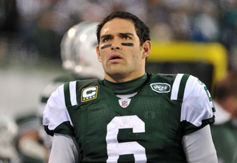 EAST RUTHERFORD, NJ - DECEMBER 24: Mark Sanchez #6 of the New York Jets talks on the bench during the second half against the New York Giants on December 24, 2011 at MetLife Stadium in East Rutherford, New Jersey. (Photo by Christopher Pasatieri/Getty Ima