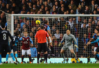 BIRMINGHAM, ENGLAND - DECEMBER 21: Yossi Benayoun of Arsenal scores the second goal goal during the Barclays Premier League match between Aston Villa and Arsenal at Villa Park on December 21, 2011 in Birmingham, England.  (Photo by Laurence Griffiths/Gett