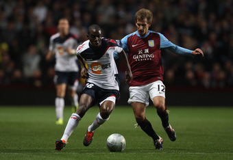 BIRMINGHAM, ENGLAND - SEPTEMBER 20:  Gael Kakuta (L) of Bolton Wanderers challenged by Marc Albrighton (R) during the Carling Cup third round match between Aston Villa and Bolton Wanderers at Villa Park on September 20, 2011 in Birmingham, England.  (Phot