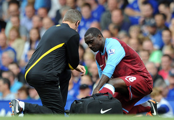 LIVERPOOL, ENGLAND - SEPTEMBER 10:  Emile Heskey of Aston Villa receives treatment during the Barclays Premier League match between Everton and Aston Villa at Goodison Park on September 10, 2011 in Liverpool, England.  (Photo by Chris Brunskill/Getty Imag