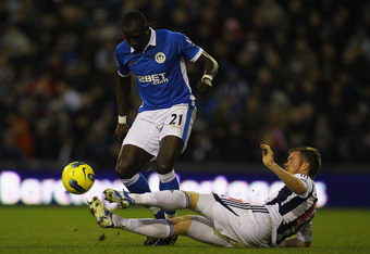 WEST BROMWICH, ENGLAND - DECEMBER 10:  Chris Brunt of West Bromwich Albion tackles Mohamed Diame of Wigan during the Barclays Premier League match between West Bromwich Albion and Wigan Athletic at The Hawthorns on December 10, 2011 in West Bromwich, Engl