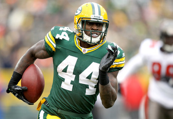 GREEN BAY, WI - NOVEMBER 20: James Starks #44 of the Green Bay Packers carries the ball after making a reception against the Tampa Bay Buccaneers at Lambeau Field on November 20, 2011 in Green Bay, Wisconsin.  (Photo by Matthew Stockman/Getty Images)