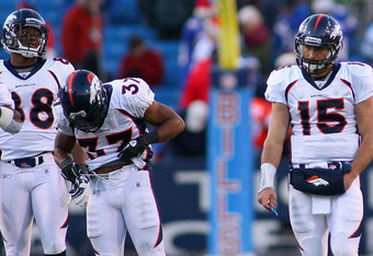 ORCHARD PARK, NY - DECEMBER 24: Tim Tebow #15 of the Denver Broncos stands on the field after throwing an interception in the fourth quarter aginst the Buffalo Bills at Ralph Wilson Stadium on December 24, 2011 in Orchard Park, New York. Buffalo won 40-14