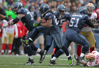 SEATTLE - DECEMBER 24:  Running back Marshawn Lynch #24 of the Seattle Seahawks rushes against the San Francisco 49ers at CenturyLink Field on December 24, 2011 in Seattle, Washington. (Photo by Otto Greule Jr/Getty Images)