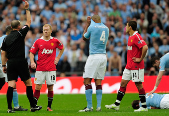 LONDON, ENGLAND - APRIL 16: Referee Mike Dean shows Paul Scholes a red card after his high footed challenge Pablo Zabaleta of Manchester City during the FA Cup sponsored by E.ON semi final match between Manchester City and Manchester United at Wembley Sta