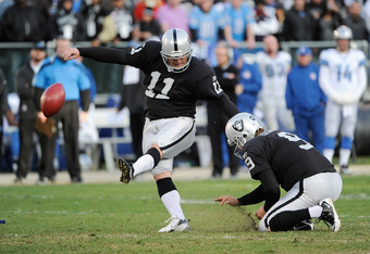 OAKLAND, CA - DECEMBER 18: Shane Lechler #9 of the Oakland Raiders holds for Sebastian Janikowski #11 who kicks a fifty one yard field goal in the fourth quarter against the Detroit Lions at O.co Coliseum on December 18, 2011 in Oakland, California.  (Pho