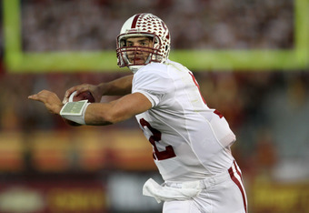 LOS ANGELES, CA - OCTOBER 29:  Quarterback Andrew Luck #12 of the Stanford Cardinal throws a pass as he scrambles against the USC Trojans at the Los Angeles Memorial Coliseum on October 29, 2011 in Los Angeles, California.  (Photo by Stephen Dunn/Getty Im