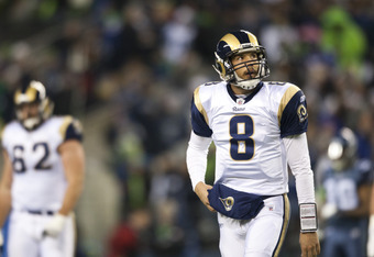 SEATTLE, WA - DECEMBER 12:  Sam Bradford #8 of the St. Louis Rams leaves the field after an unsuccessful attempt for a first down against the Seattle Seahawks at CenturyLink Field December 12, 2011 in Seattle, Washington. Seattle won 33-13. (Photo by Jay