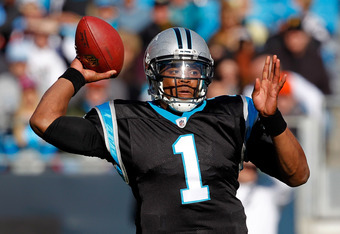 CHARLOTTE, NC - DECEMBER 11:  Cam Newton #1 of the Carolina Panthers drops back to pass against the Atlanta Falcons during their game at Bank of America Stadium on December 11, 2011 in Charlotte, North Carolina.  (Photo by Streeter Lecka/Getty Images)