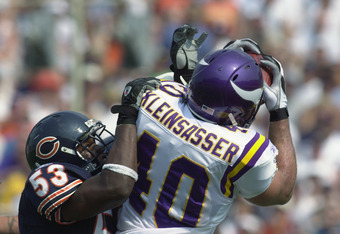 CHAMPAIGN, IL - SEPTEMBER 8:  Running back Jim Kleinsasser #40 of the Minnesota Vikings catches a pass over linebacker Warrick Holdman #53 of the Chicago Bears during the NFL game at Memorial Stadium at the University of Illinois on September 8, 2002 in C